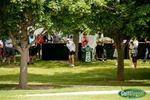 Jennifer Song plays out of the concession area near the eighteenth green.
